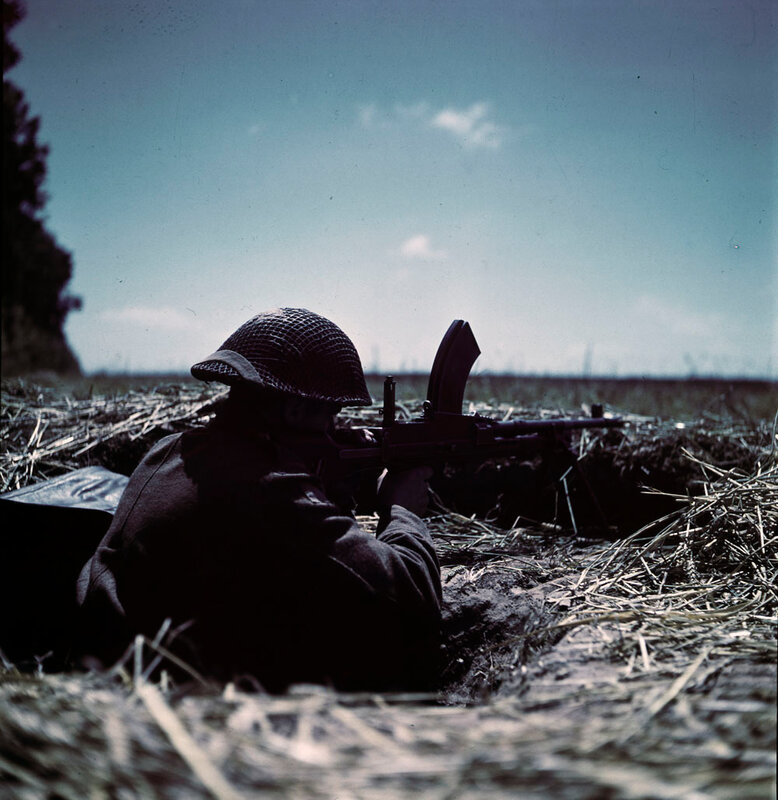 Canadian gunner at positions in France with a 303 Bren gun