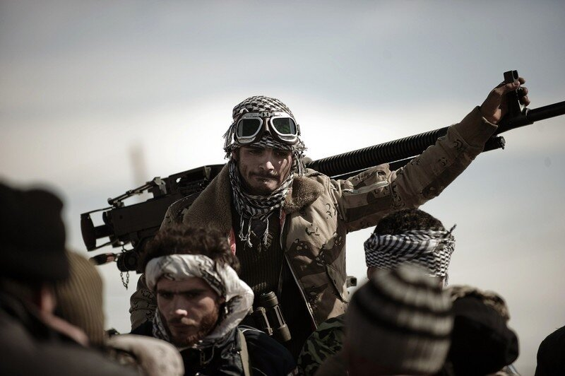 A Libyan rebel fighter stands by a machi
