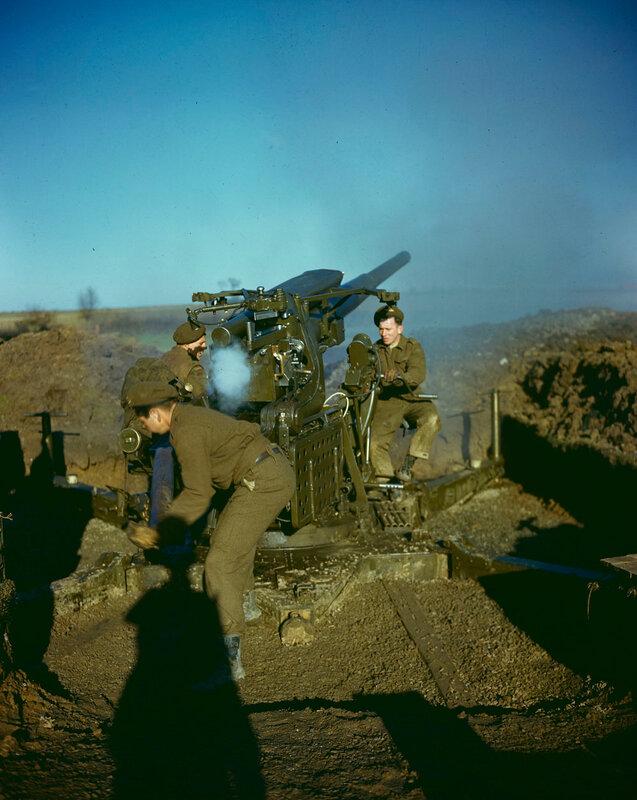Canadian Gunners firing a 94-mm anti-aircraft gun (Ordnance QF 3.7 inch) around Dunkirk 1944