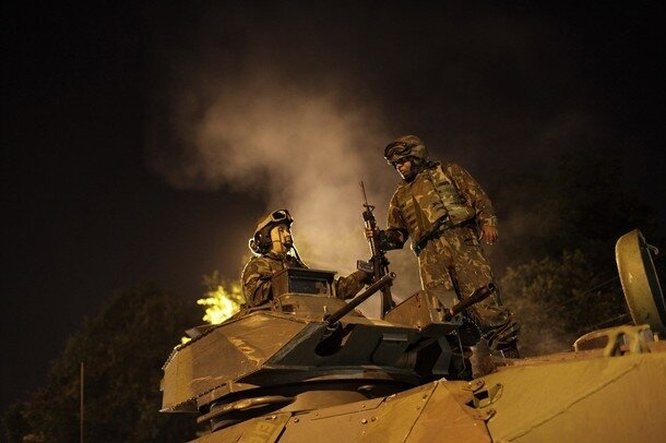 Brazilian Navy soldiers in an armoured vehicle prepare for an operation against drug dealers at Mangueira slum in Rio de Janeiro