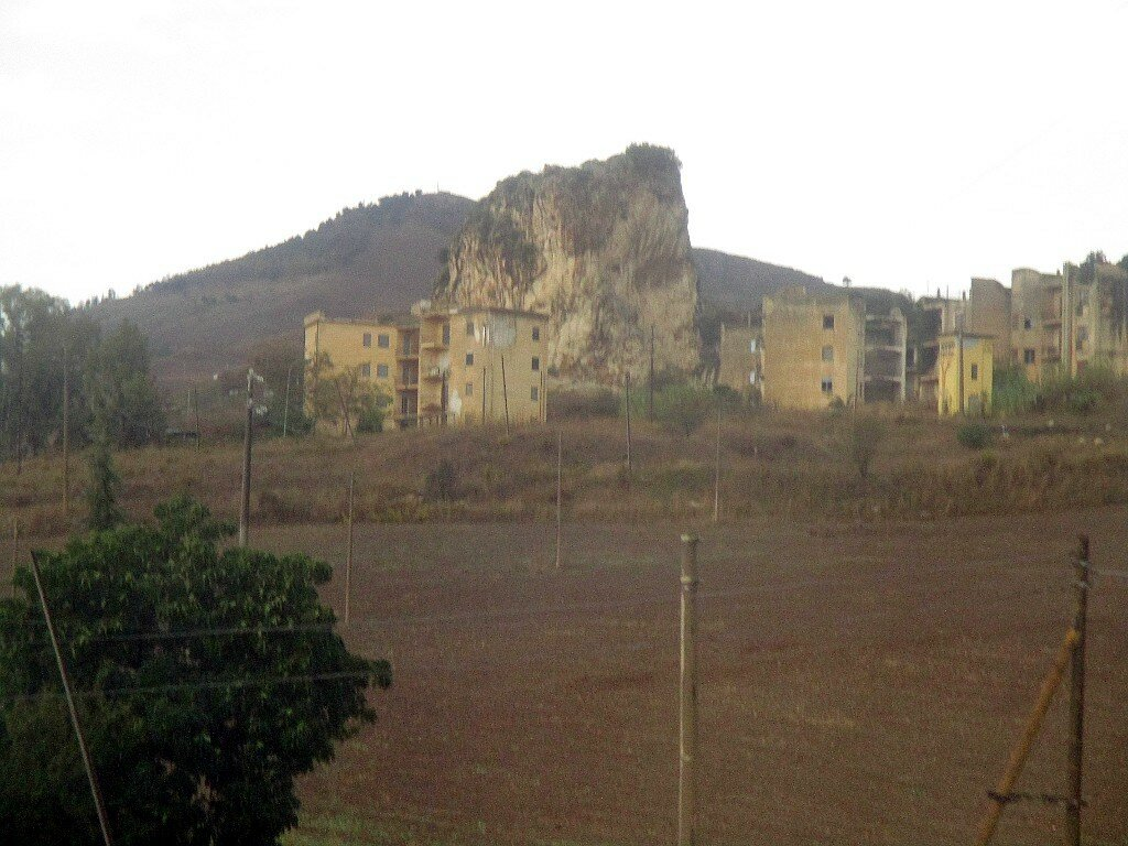 Abandoned mining village and La Rocca rock)