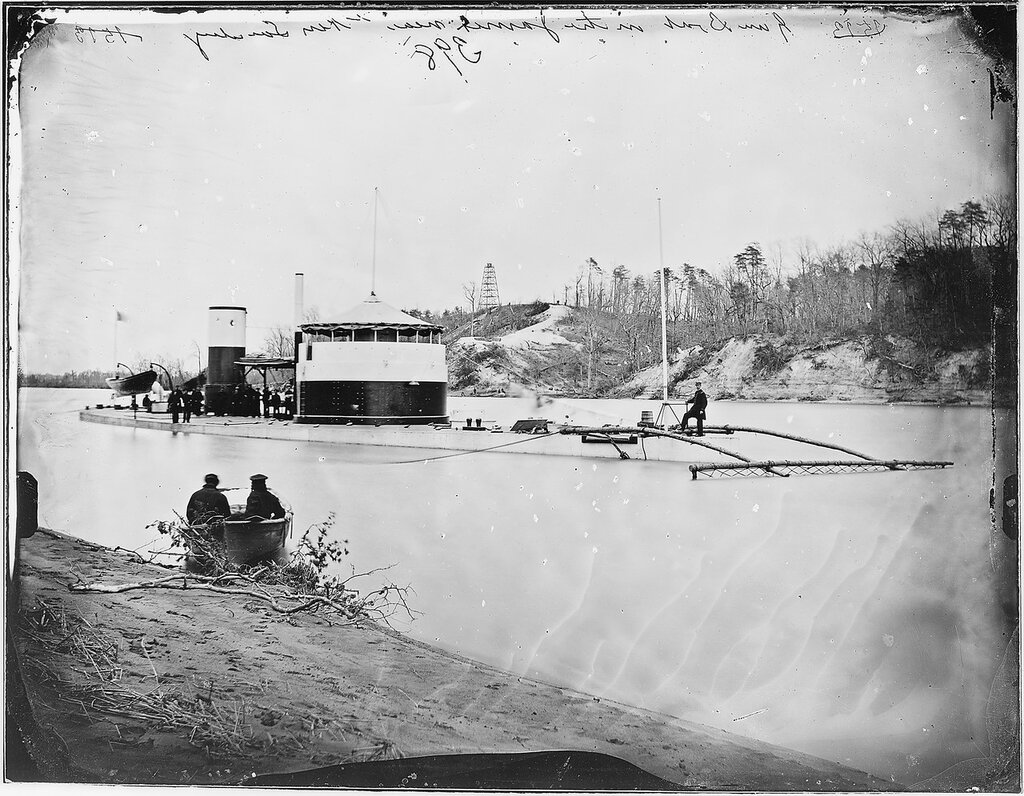 """Saugus, in Trent's Reach on the James River, Virginia, circa early 1865. The mine sweeping """"rake"""" attached to her bow"""