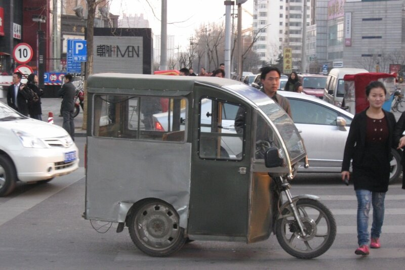 Тук-туки на улицах пекина