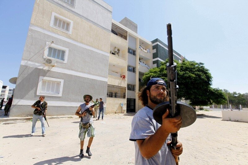 Rebel fighters scout for snipers in the final push to flush out Muammar Gaddafi's forces in Abu Slim in Tripoli