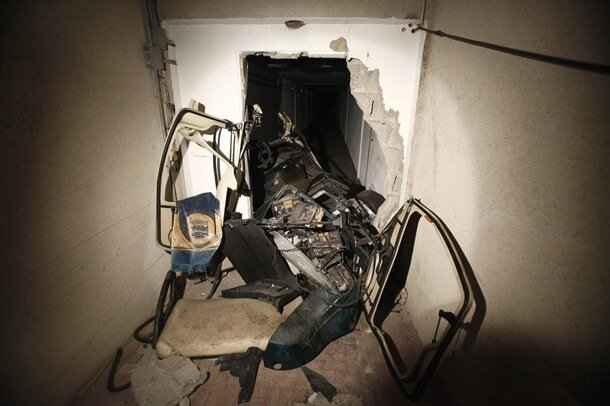 A golf buggy belonging to Muammar Gaddafi is seen at a tunnel in the ransacked Bab al-Aziziya compound in Tripoli