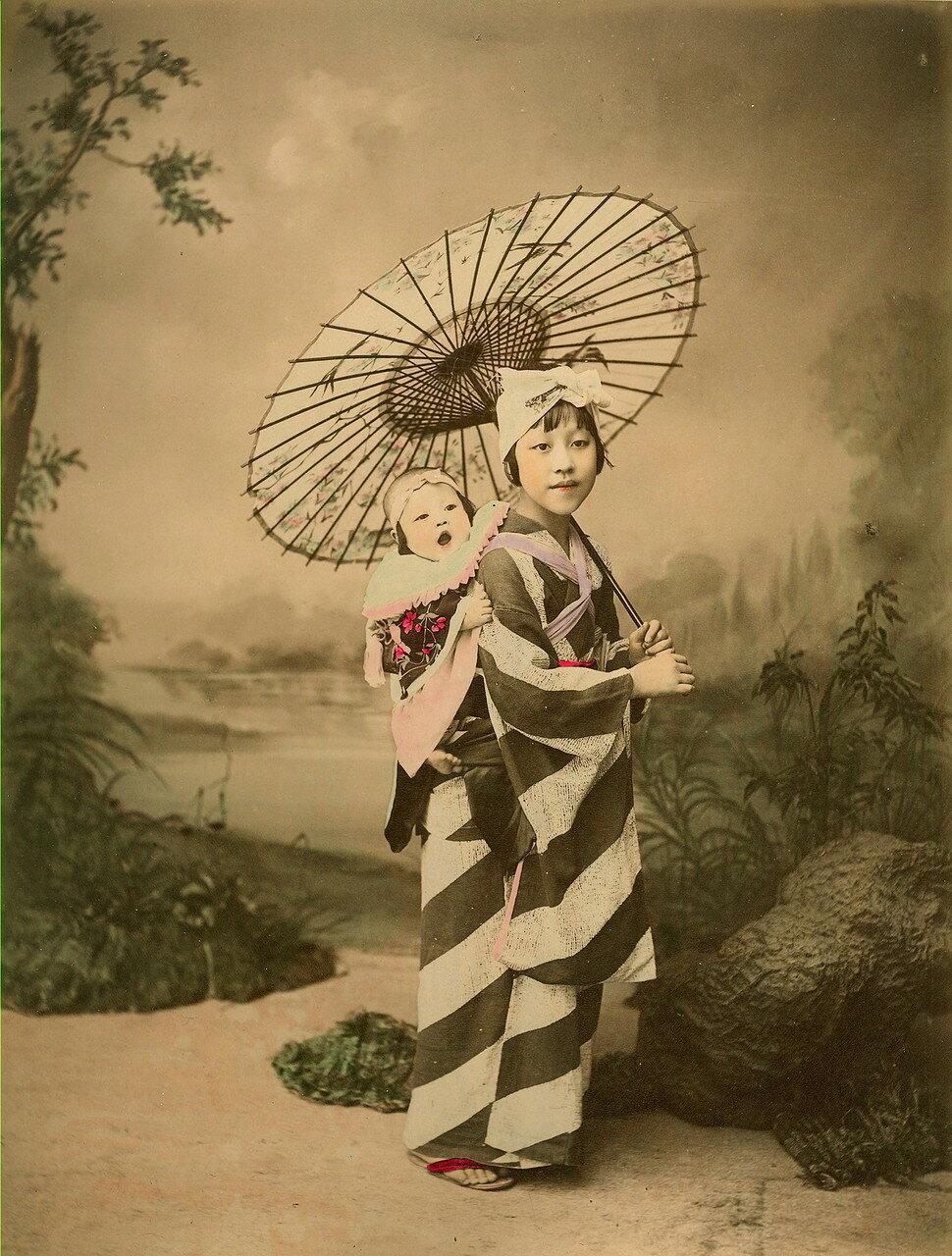 Молодая девушка с ребенком на руках. 1880