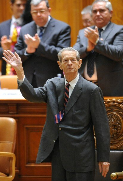 King Michael I of Romania (C) receives a