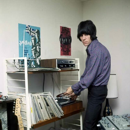 Jeff Beck listening to music at home (complete with Yardbirds posters), 1967