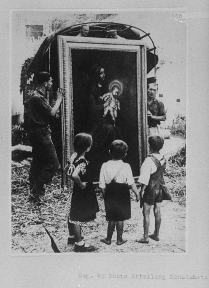 Children watching Germans unloading ptgs