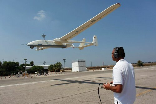 An Israel Aerospace Industries instructor controls a drone near Hadera