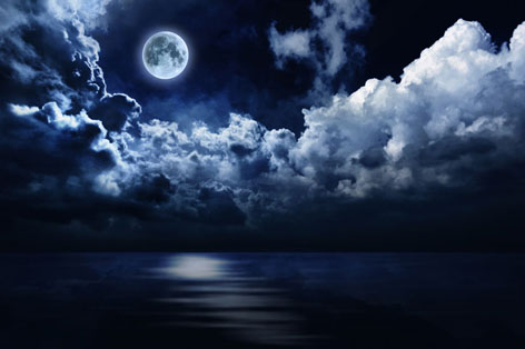 full-moon-in-night-sky-over-water.jpg