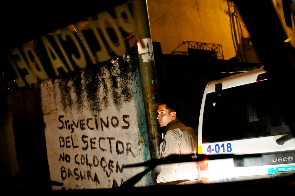 Members of a special tactical division of the Sucre police force conduct a late night foot patrol in Petare, a slum  in Caracas, Venezuela.