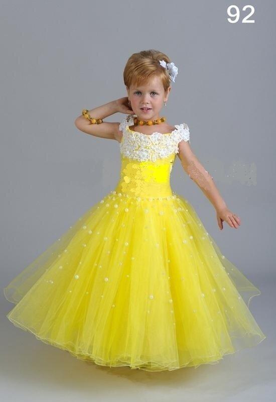 B Нарядное детское платье Фея золотого цвета.