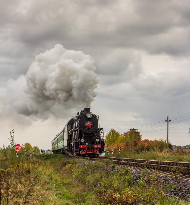 Retro steam train approaches mountains