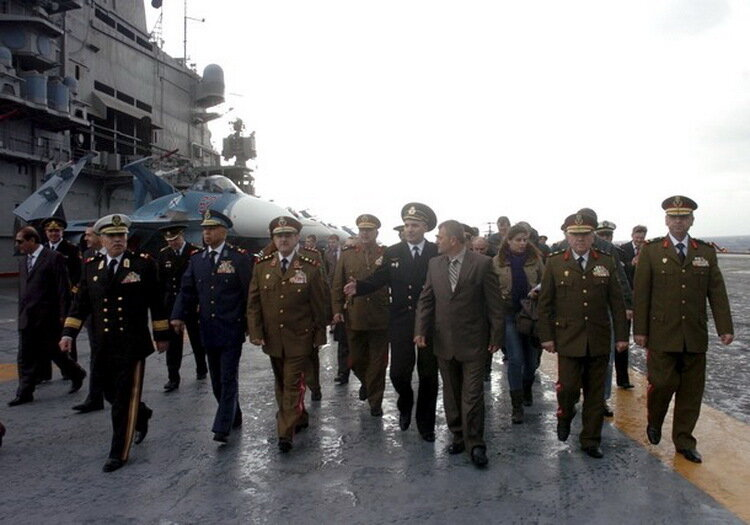 Syria's Defense Minister General Dawood Rajiha visits the Russian aircraft carrier Kuznetsov in Tartous