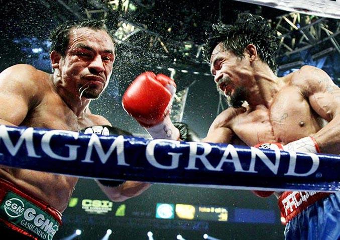 спортивный год 2011 - боксерский поединок между Мэнни Пакьяо и Хуаном Мануэлем Маркесом