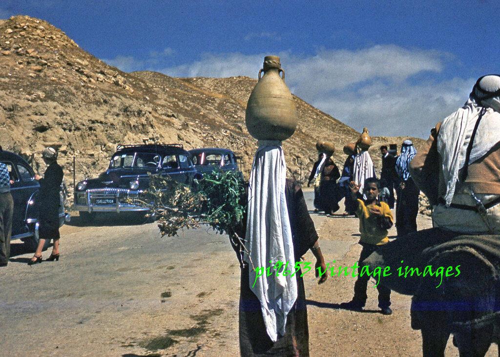 1950s Israel New Jericho Women Carrying Water from Spring Elijah Sweetened Jars.JPG