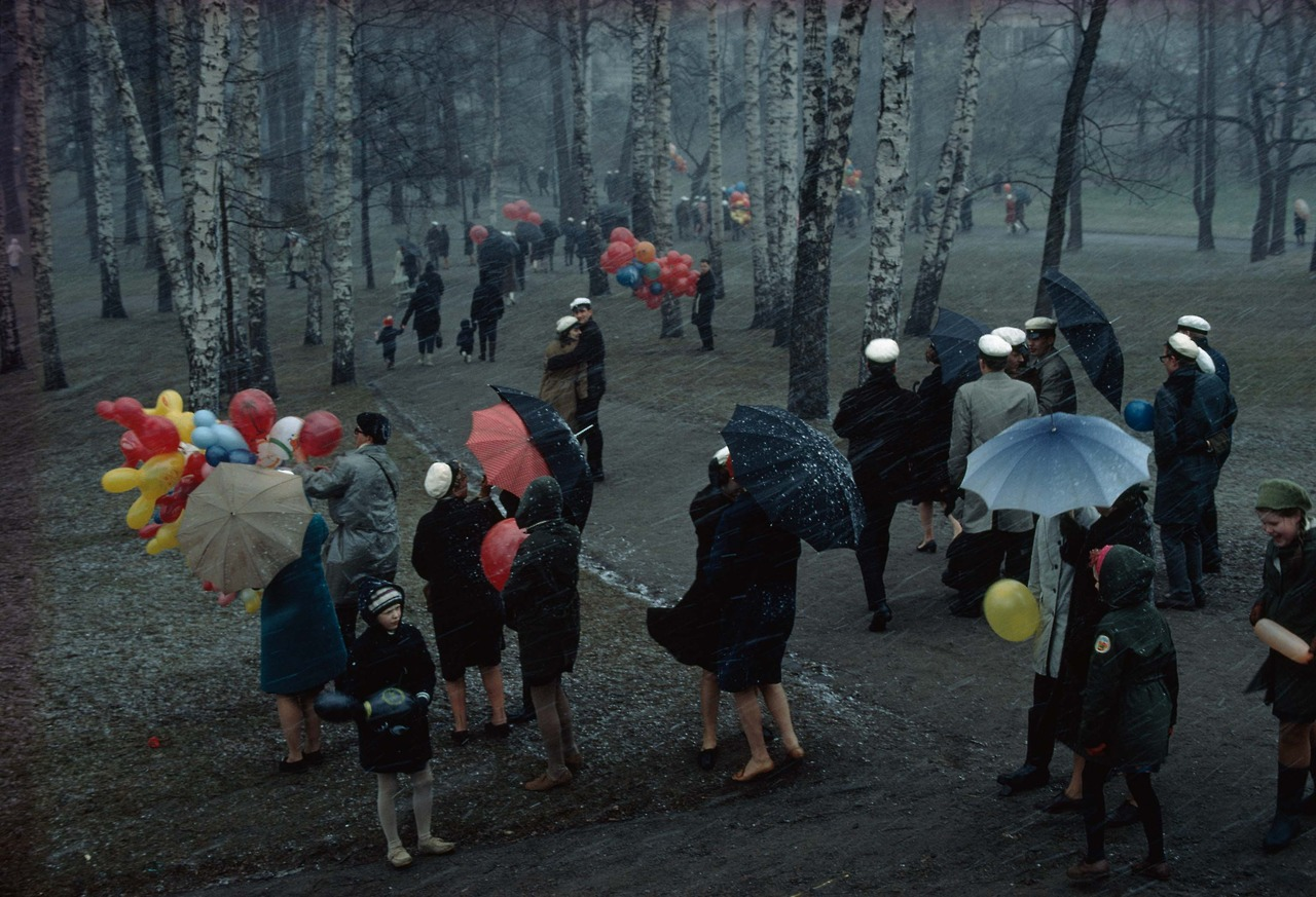People strolling through a park in Finland during a wet May snowstorm, 1968.Photograph by George F. Mobley