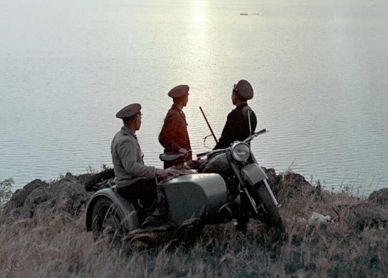 1972 Game-keepers patrol a lake bank by motorcycle.jpg