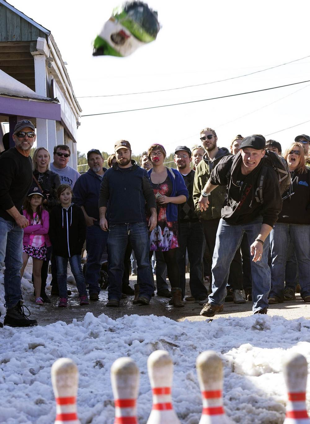 A man competes in Frozen Turkey Bowling event at Frozen Dead Guy Days in Nederland