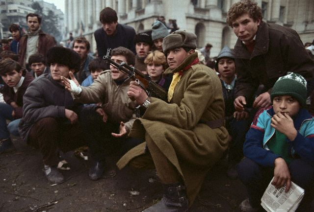 Soldier Sitting with Crowd