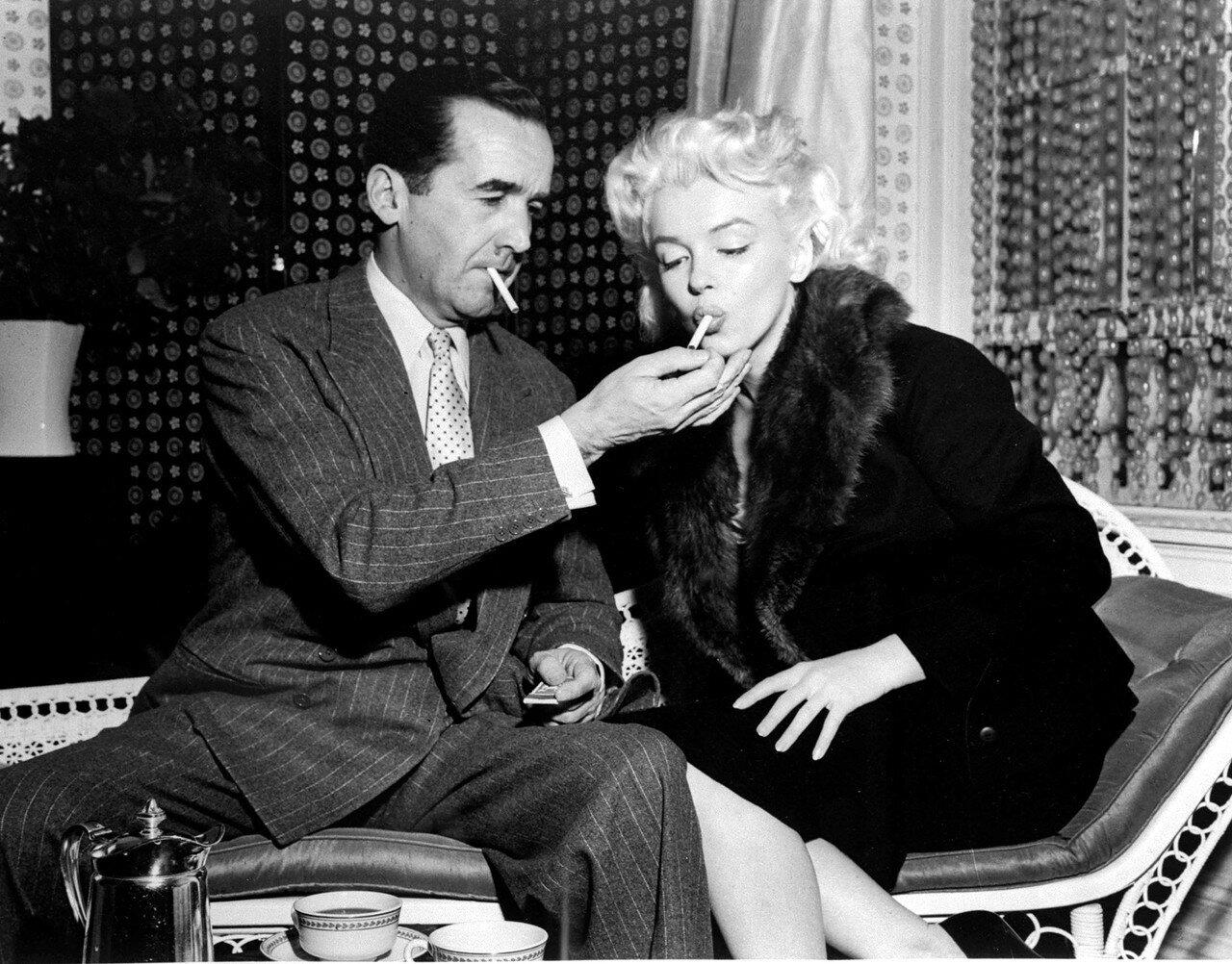 Edward R. Murrow Lights Cigarette For Marilyn Monroe