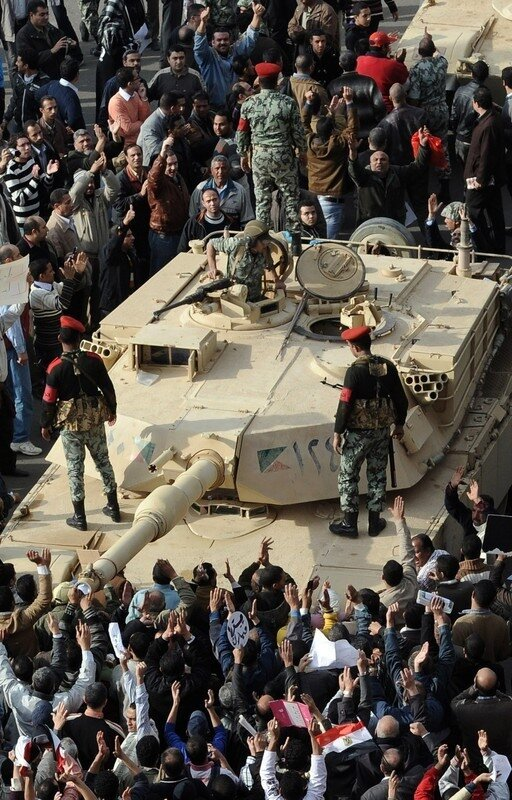 Egyptian soldiers stand on their Abrams
