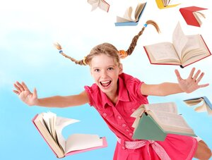 Schoolgirl  holding pile of books.