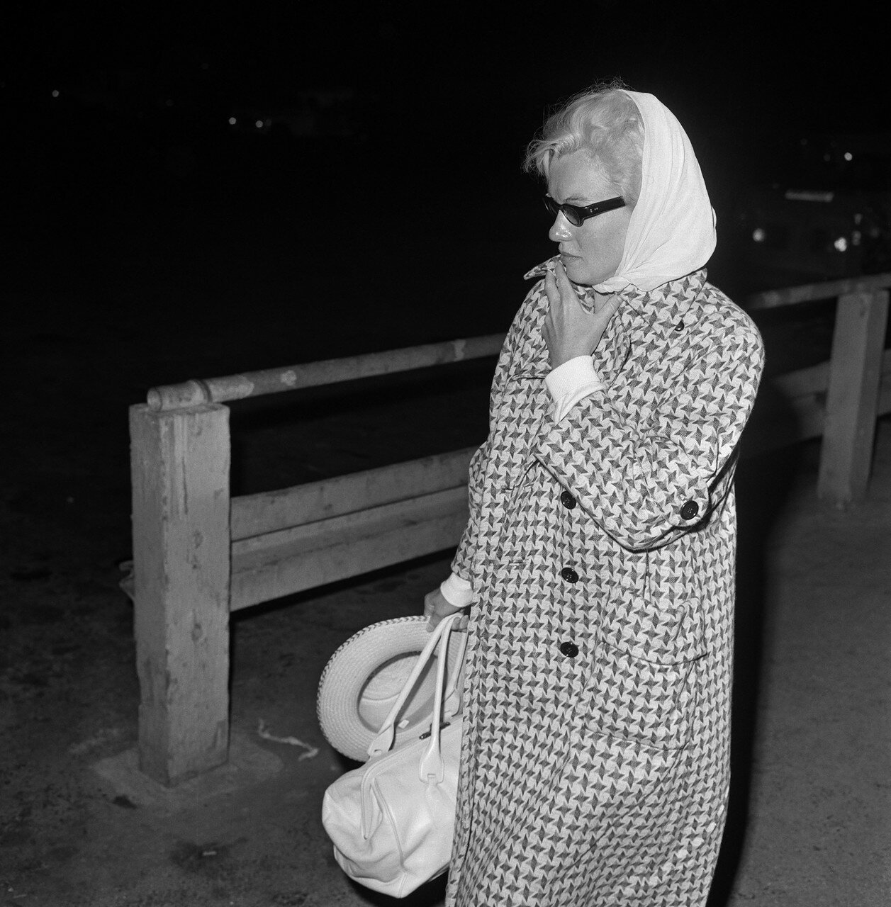Marilyn Monroe Wearing Checkered Coat and Carrying Luggage