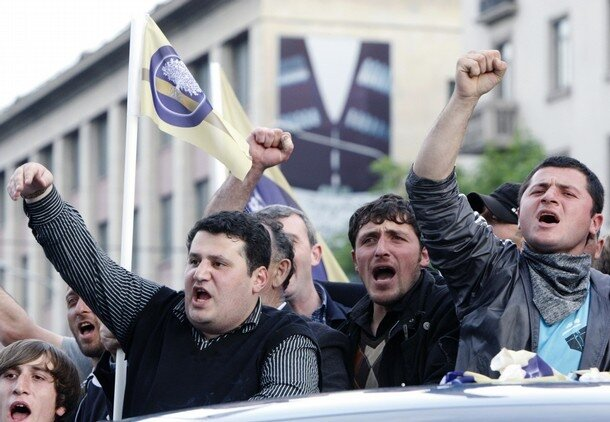 Opposition supporters shout slogans during a rally in Tbilisi