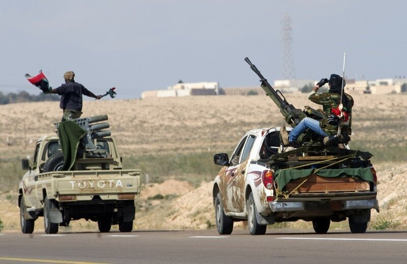 Rebel fighters drives towards the univer