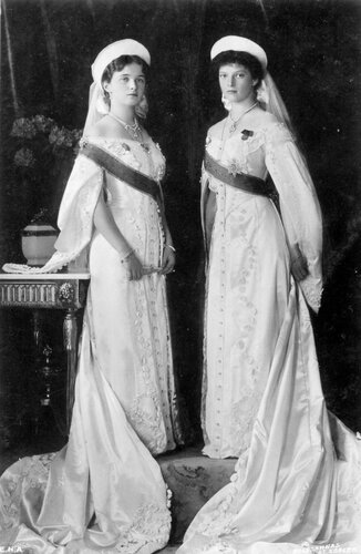 Grand Duchesses Olga and Tatiana in court dress in a formal portrait taken in 1913.