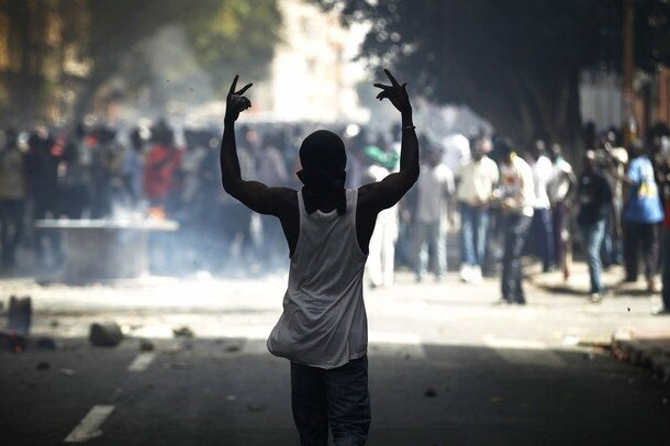 A protester gestures during a violent demonstration in Senegal's capital Dakar