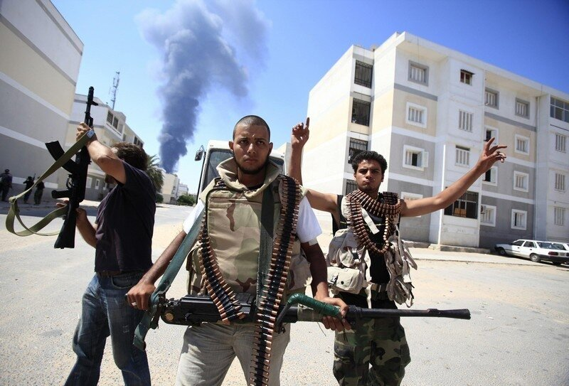 Libyan rebel fighters react as they search for snipers during final push to flush out Gaddafi forces in Tripoli