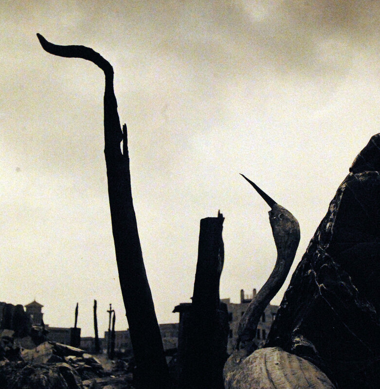 Photographing devastation created by U.S. bombings at Yokohama, Japan, during World War. September 1945