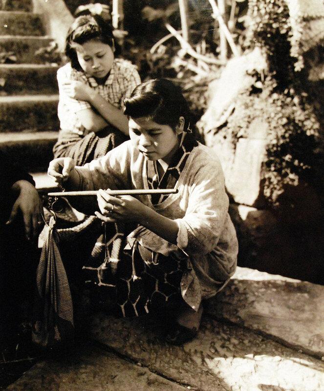 Scene at Sasebo, Kyushu, shows women weighing potatoes. October 19, 1945