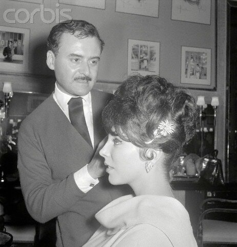 Movie Star Joan Collins Modeling New Hairstyle