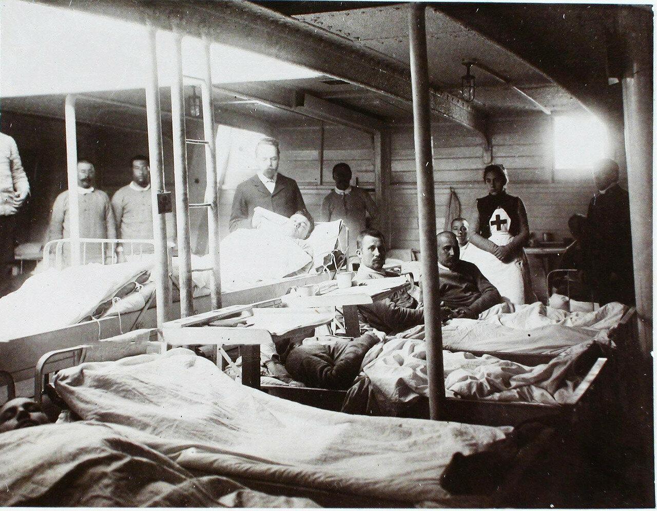 20. Младший врач А. А. Косминский (стоит в центре) у постели больного в палате № 1. 1901
