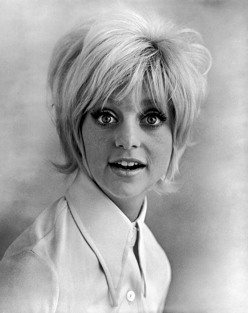 "Promorional studio headshot portrait of American actor Goldie Hawn wearing a wide collared shirt for the film, ""Cactus Flower,"" directed by Gene Saks, 1969."