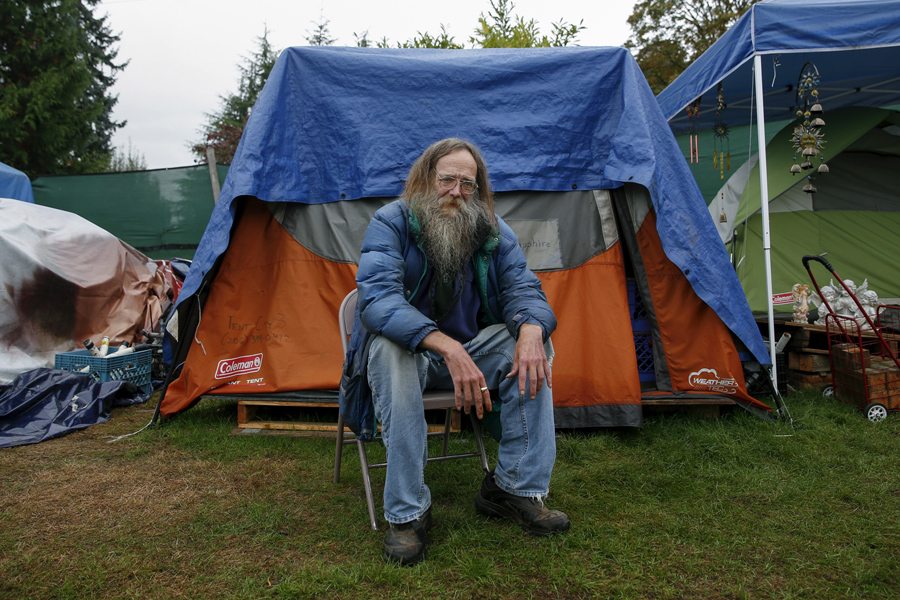 Lantz Rowland, 59, poses in front of his tent at SHARE/WHEEL Tent City 3 near Seattle on October 8,