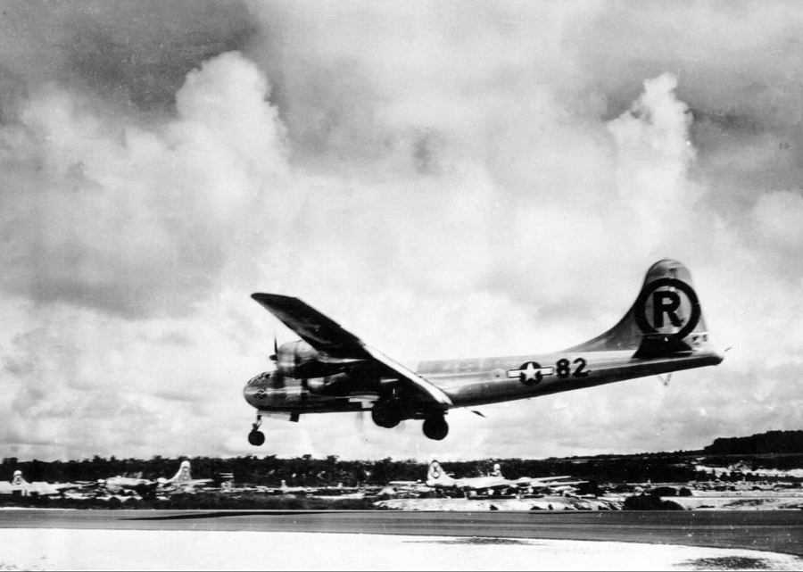 The B-29 superfortress Enola Gay lands at its Tinian base after its its historic bombing mission ove