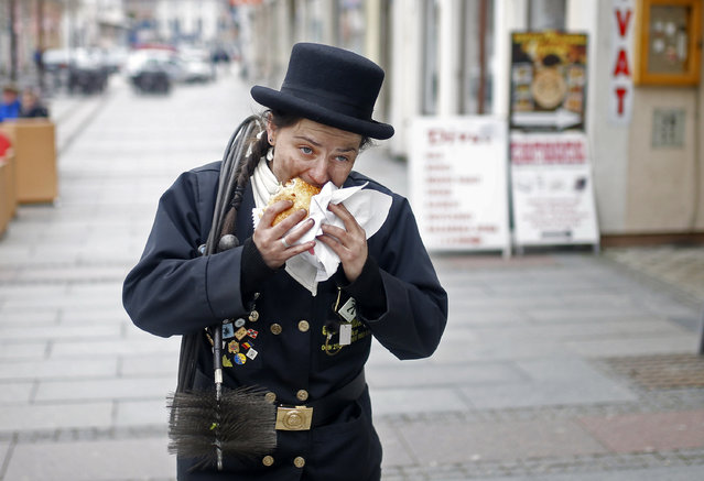 Dajana Djuric, 25, who has worked as a chimney sweep since the age of six, eats after cleaning chimn
