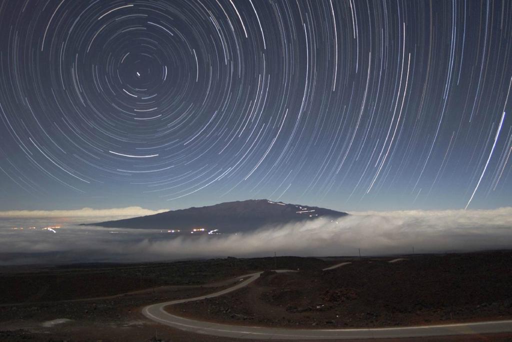 режим съемки звездного неба принято называть нижнее