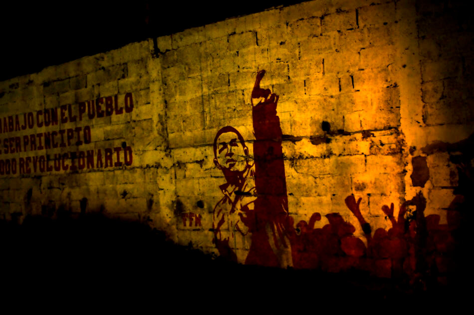 Political graffiti of Venezuelan President Hugo Chavez on a wall in Petare, a slum where members of a special tactical division of the Sucre police force conduct late night foot patrols in Caracas, Venezuela.