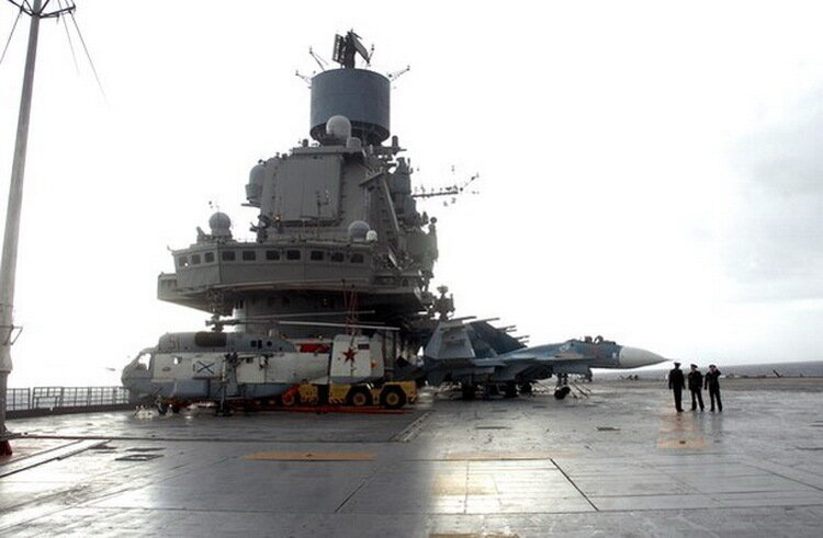 A view of the Russian aircraft carrier Kuznetsov in the Syrian city of Tartous on the Mediterranean sea