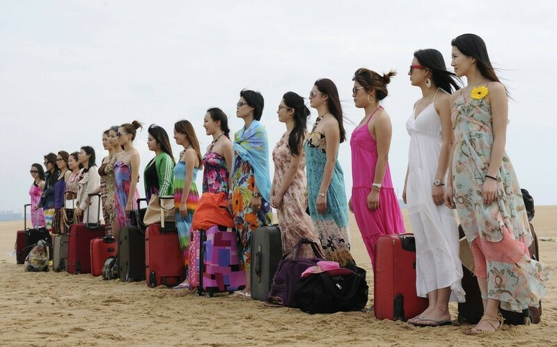 Trainees gather at beach as they wait for beginning of training session for female bodyguards in Sanya