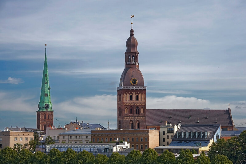 View on the towers of Riga Cathedral, St Peters Church and the English Church in Riga, Latvia, by the river Daugava.