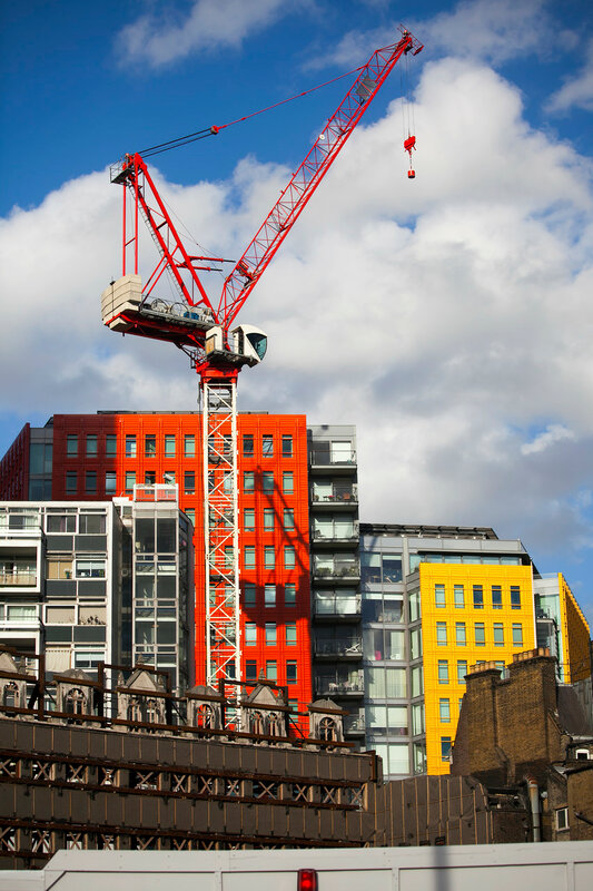 Bright-coloured facade of the modern Central Saint Giles mixed-use development in London, England.