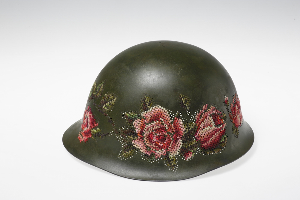 Floral Elements Embroidered Directly on Antique Soldiers' Helmets