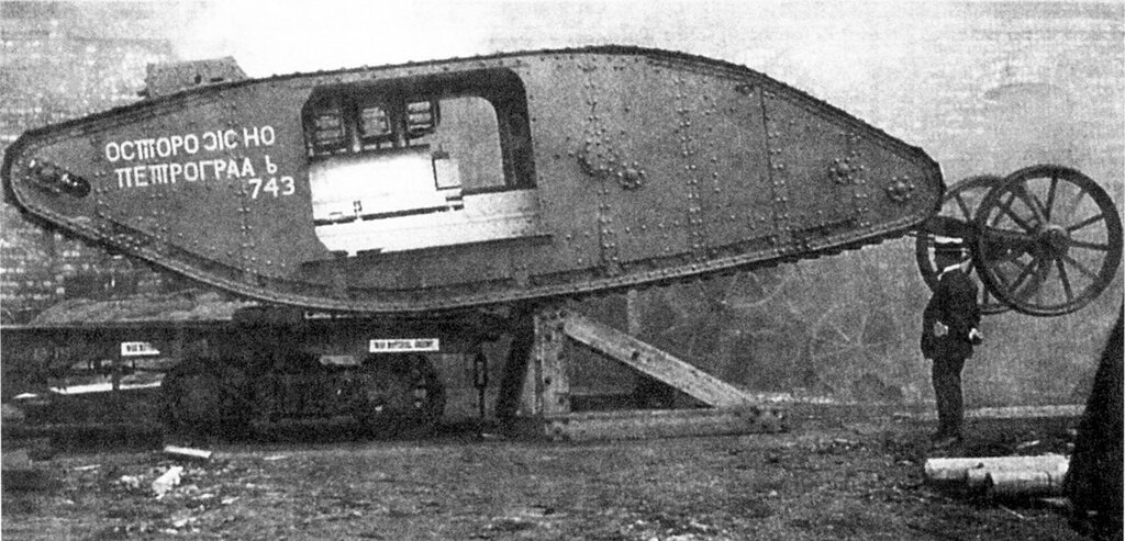a tank with Russian script and devoid of gun sponsons being loaded at Lincoln for delivery to the training range at Elveden.